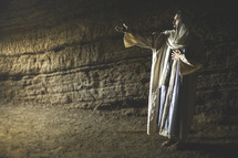 Jesus standing in a cave