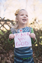 "girl holding a sign that says ""Thank You God"""