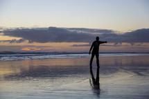 silhouette of a man on a beach