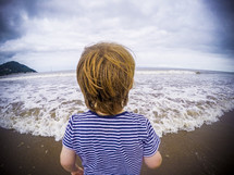 a child walking on a beach