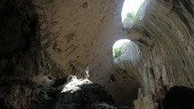 a man standing in a cave looking up