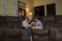 a mother reading a Bible to her daughters