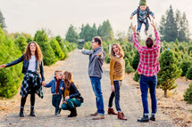 Family, fun photo, joy, Christmas, Christmas tree farm