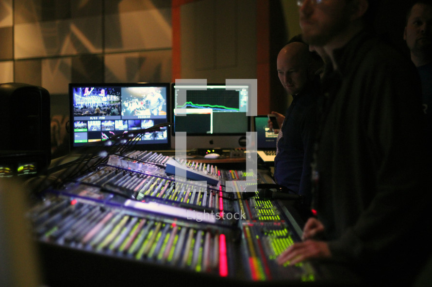 video production crew -- sound board operators