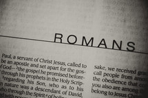 A close up of the book of Romans