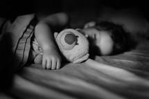 child sleeping with a teddy bear