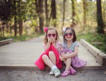 children in sunglasses sitting outdoors