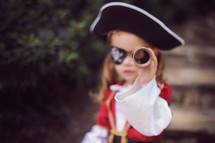 a child dressed up as a pirate