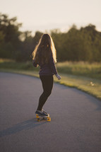 teen girl on a skateboard