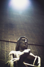 sunlight on a statue of Jesus