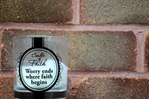 Candle of Faith, Worry ends where faith begins, candle, brick wall