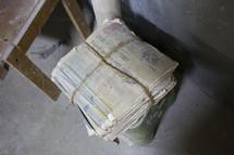 bundled stack of newspaper