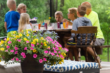 family eating around a table outdoors