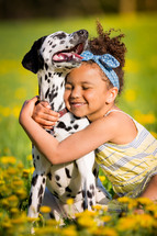 a girl hugging a dog
