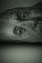 A close up look at a one hundred dollar bill