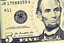 Abraham Lincoln on a five dollar bill