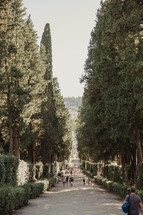 people walking on the paths in a garden in Italy