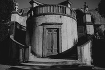 circular staircase in front of a house in Italy