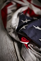 A crumpled up American Flag