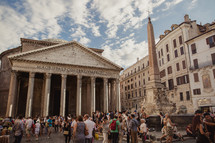 tourists touring old historic buildings in Italy
