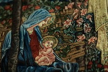 Mary and baby Jesus stitched into fabric