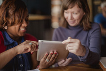 women looking at an iPad