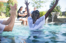 a man being baptized in water