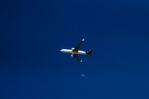 an airplane flying and moon