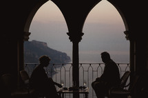 a couple having dinner on a balcony in Italy