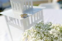 wedding rings on a lantern