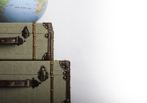 globe on suitcases