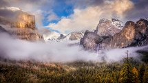fog rising above a mountain valley and waterfall