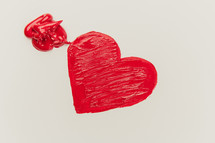 a red heart on white paper