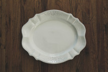 white serving plate on a wood table