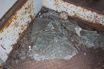 broken glass on a metal floor