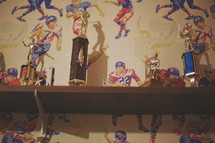 a vintage shelf of past sports trophies