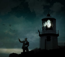 man tossing the pages of a book in front of a glowing lighthouse