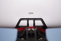 word love typed on a typewriter