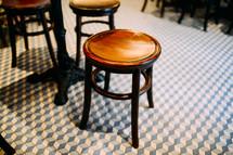 bar stools on a tile floor