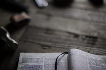 an open Bible on a workbench