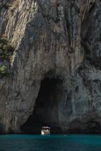 boat entering a sea cave