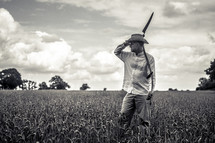 a man with a blade in a wheat field