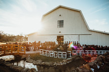 outdoor wedding ceremony by an old barn