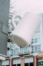 large coffee mug sign