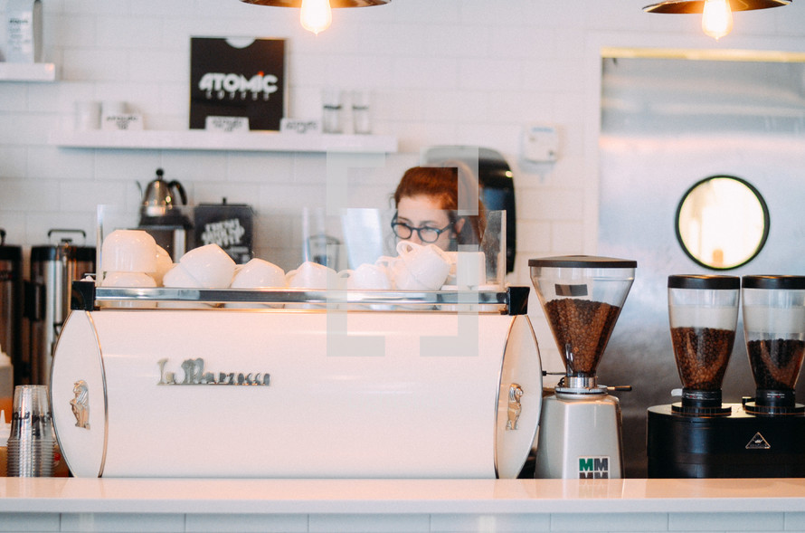 barista making coffee in a coffee shop