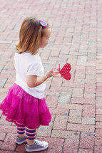 girl toddler holding a heart