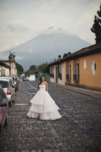 bride in bridal gown on a cobblestone street