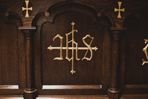 Woodworking on an altar with gold lettering