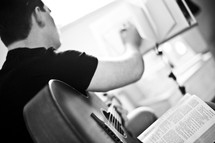 Playing guitar and reading the bible