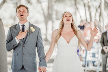 bride and groom singing praises to God